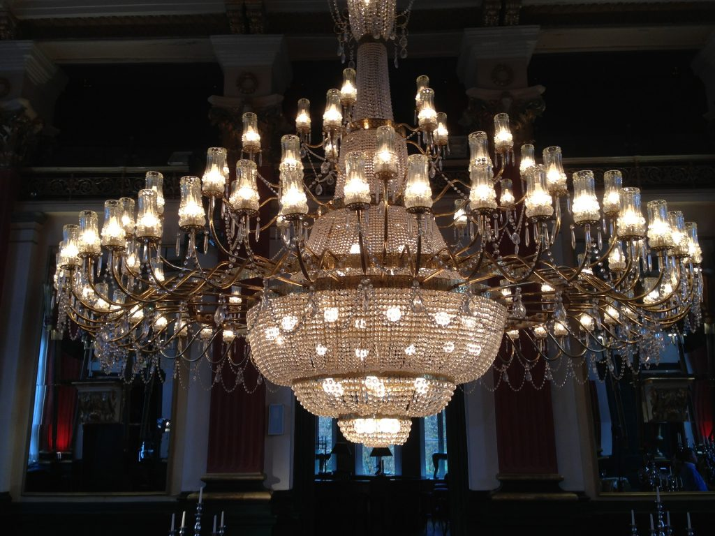 An ornate chandelier, fully lit
