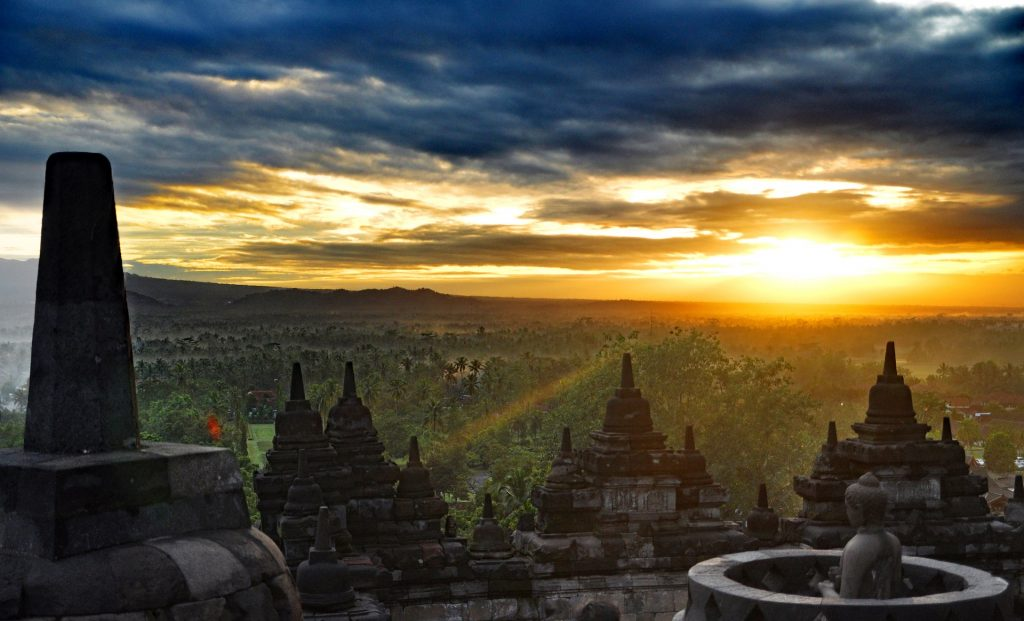 Breathtaking sunrise view from the top of the largest Buddhist temple on Earth, in Indonesia. I don't know if I could achieve boredom here, but I could probably find some Nirvana
